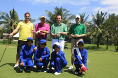 Ian Morgan (pink) with a group of golfers at Thai CC